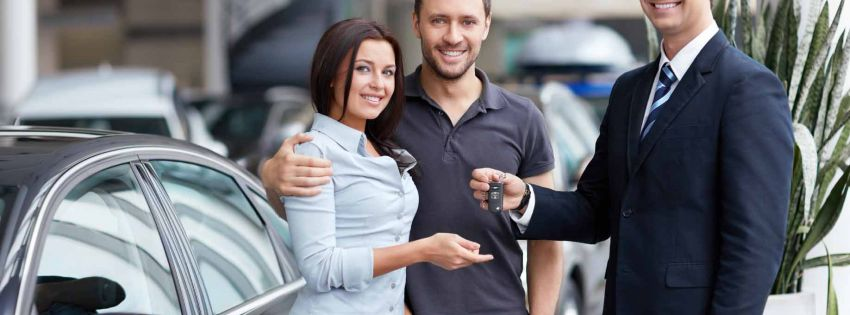 couple receiving car keys